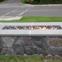 Customer Fire pit with fire glass in it