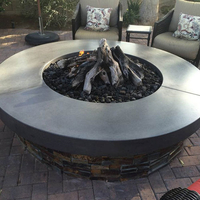 Customer fire pit with lava rock and gas logs